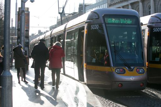 Luas passengers at the St Stephen's Green stop in Dublin yesterday Photo: Gareth Chaney