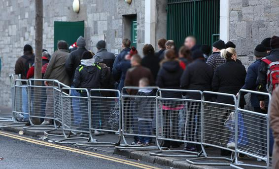 People queueing to receive Christmas hampers at the Capuchin Day Centre.