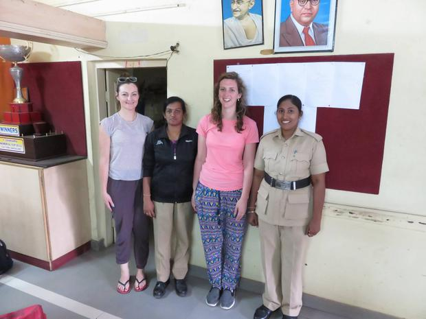 Irish teachers Annette McGroary and Elaine O'Leary with two Indian police officers in Bangalore