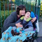 Tracy with her 11-year-old son Brendan. Tracy said carers and vulnerable people are being failed by the government