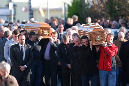 The remains of Kitty and Tom Fitzgerald are carried from the Church of the holy family in Irishtown, Co. Mayo after their funeral mass. Photo: Damien Eagers