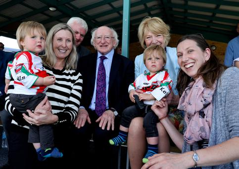 President Higgins and his wife Sabina meet Nollag Trevarthen, her sister Blatnhaid Napier and her 16-month-old twins Dara and Cody at the Australasian Championships Finals in the Tom Bateman complex in Perth. Photo: Maxwells