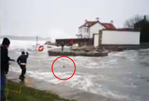 A still image from the video showing the woman's rescue