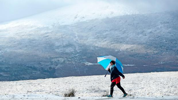 A walker enjoys the snow in the mountains near Killakee, to the south east of Dublin. Niall Carson/PA Wire