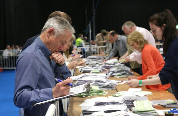 NUMBERS: Fine Gael's Richard Bruton keeps watch at the RDS. Photo: Damien Eagers