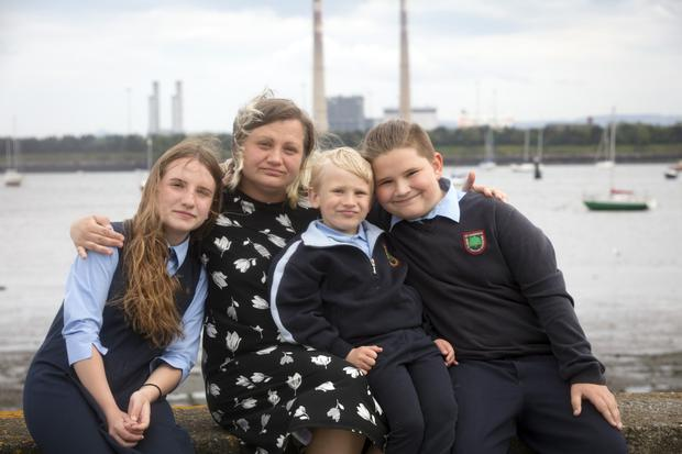 Life in a family hub: Irina Fiodorova with her children Irina (12), Octavian (10) and Bogdan (5) in Dublin. Picture: Arthur Carron