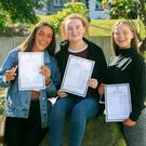 Girl power: From left is Ciara Rogerson, Aoife Swan and Saoirse Mangan with their results in Blackrock, Dublin. Photo: Collins