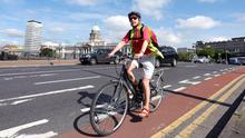 A cylist using the cycle path over the Matt Talbot Bridge in Dublin