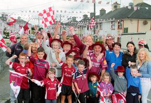 Top: Galway fans have covered their street, St Brendan's Terrace, Ballinasloe, in maroon and white