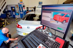 A Volkswagen Passat CC is tested for its exhaust emissions at a Ministry of Transport (MOT) testing station in London yesterday
