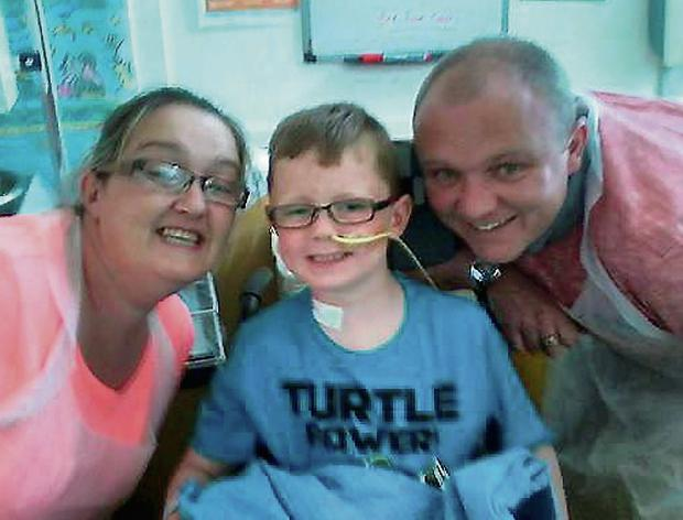Gillian and Karl Scully with Sean, who was shot by accident