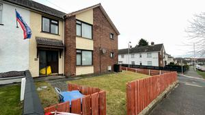 The scene at a residential property in the Derrycoole Way, Newtownabbey, after police launched a murder investigation after three bodies were found at separate properties. PA Wire