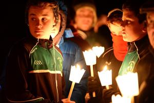 St Patrick's GAA club members at the candle-lit vigil for Adrian Donohoe