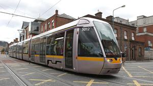 A Luas tram passes the junction at Blackhall Place in Dublin City centre. Photo: Damien Eagers/INM