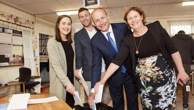 GETTING THE VOTE OUT: Fianna Fail party leader Micheal Martin with his wife Mary, daughter Aoibhe and son Micheal Aodh. Photo: Daragh McSweeney/Provision