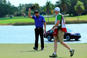 Padraig Harrington tips his cap after making his putt on the 18th green during the Honda Classic at PGA National Resort & Spa in Palm Beach Gardens, Florida yesterday. Photo: Getty
