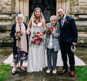 Megan and Tom with the their bridesmaids Mary Kennedy (90) and Gillian Holloway (80). PIC: Belfast Telegraph