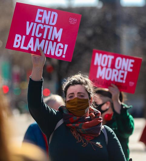 A woman in tears holds up a sign during speeches at a protest in Dublin to highlight violence against women in the wake of the murder of Sarah Everard.