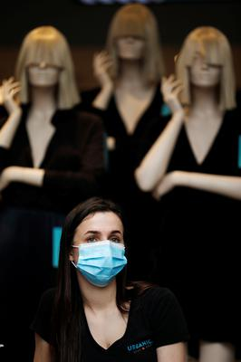 A vendor wears a face mask while standing at the entrance to a store at a fashion shopping center in Ashdod, as restrictions over the coronavirus disease (COVID-19) ease around Israel, May 5, 2020. Picture: Reuters