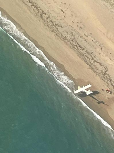 Light aircraft crash lands on beach in Co Wexford. Photo credit: James Cook