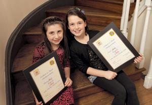 Pictured at the 14th South West Inner City Network Youth Achievement and Community Awards are sisters Shauna (8) and Niamh Devlin (9) who both received writing awards.
