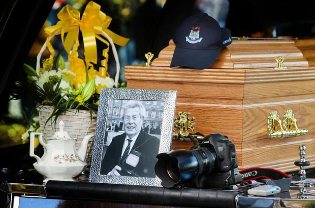 The remains of former Irish Independent photographer Tom Burke await their final journey to Glencullen cemetery following his funeral mass in the Church of St John The Evangelist, Ballinteer PIC Gerry Mooney