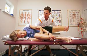 HIGH IMPACT: Physiotherapist Gerard Hartmann massages champion runner Paula Radcliffe's foot at his clinic in Limerick