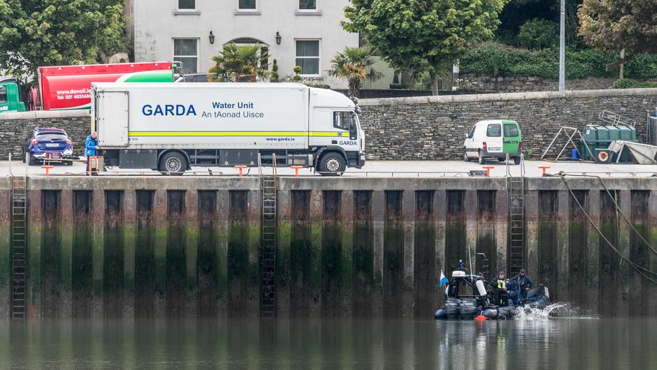 Divers from the Garda Water Unit search the area around Hugh Coveney Pier in Crosshaven, Co Cork, following the discovery of a car belonging to Barry Coughlan, as well as skeletal remains. Photo: David Creedon