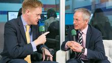 Fionnan Sheahan speaks with Richard Bruton at the Web Summit yesterday. Photo: Kyran O'Brien
