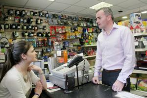 Cllr John Leahy chatting with Ashling Grimes of Kelly Office Supplies on Main Street in Birr, Co Offaly. Photo: David Walsh