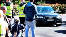 Gardaí and water protesters watch as Labour leader and Tánaiste Joan Burton leaves the Labour Party think-in at the Glenview Hotel in Wicklow