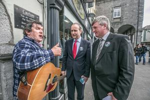 Fianna Fáil leader Micheál Martin and Kilkenny/Carlow by-election candidate Bobby Aylward meet Pat Cahill in Kilkenny
