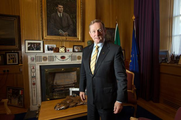 Taoiseach Enda Kenny in his office in Government Buildings with a portrait of Michael Collins behind him. Photo: Tony Gavin