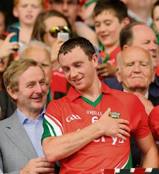 Enda Kenny with Mayo players Keith Higgins at the Connacht final in McHale Park, Castlebar