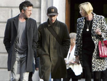Aidan Gillen and Tom Vaughan-Lawlor with Cait Hayes of the Oireachtas press office during a tour of Leinster House. The actors will portray Charlie Haughey and his press secretary PJ Mara