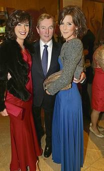 Enda Kenny pictured with sisters Kate O'Connell (left) and Theresa Newman at the annual Fine Gael President's Dinner in the Burlington Hotel