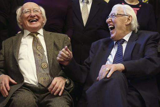 President Michael D Higgins (left) shares a joke with Ian Paisley, former First Minister of Northern Ireland, during a reception at Belfast City Hall to mark St Columbanus Day. Paul Faith/PA Wire