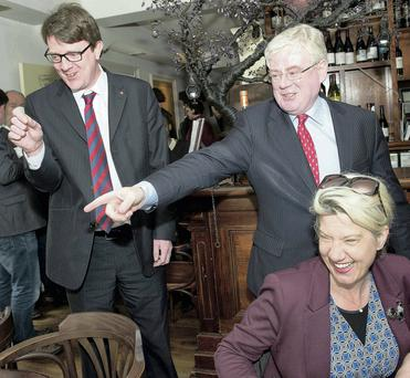 Eamon Gilmore in Galway with Cllr Niall McNelis and, right, Hazel Hendy of the Simon Community. Picture: Andrew Downes