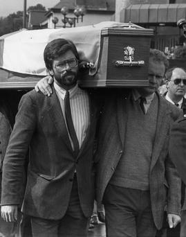 Sinn Fein President Gerry Adams and Vice-President Martin McGuinness carrying the coffin of IRA man Seamus Twomey who died September 12, 1989