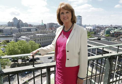 Joan Burton, TD, Minister for social protection pictured at her offices overlooking The Customs House in Dublin. Picture credit; Damien Eagers