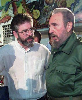 Sinn Fein President Gerry Adams, left, with Cuban President Fidel Castro in 2001. Many people polled seemed unperturbed by one of SF's traditional weaknesses: the fear that the party would turn the Republic into Cuba without the palm trees if it ever ran the economy