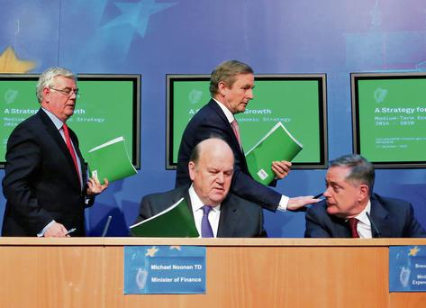 WAR ROOM CHIEFS: Eamon Gilmore, Enda Kenny, Michael Noonan, Brendan Howlin. Photo: Colin Keegan/Collins