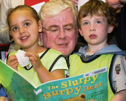 Eamon Gilmore at the Right to Read Campaign in the Charleville Mall library, North Strand, Dublin, yesterday.