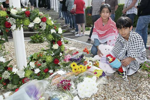 Children pay respect at Palestinian Ambassador's residence in Dublin
