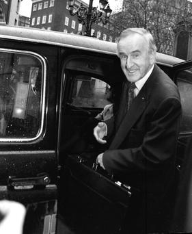 Albert Reynolds leaving court in London
