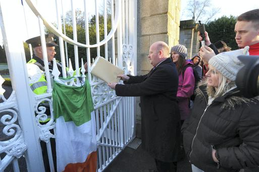 Dermot McGuckin of Kingswood/Tallaght Water Protest Group hands a petition into Aras an Uachtarain at The Phoenix Park in Dublin yesterday. Photo: C. O'Riordan