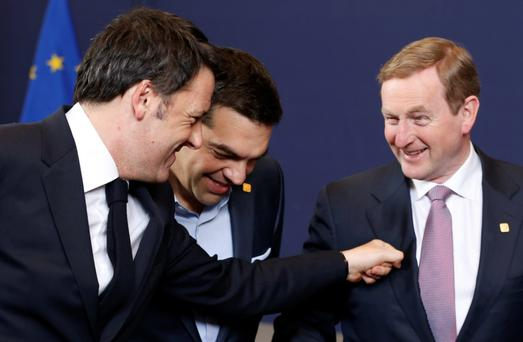 Italy's Prime Minister Matteo Renzi, his Greek counterpart Alexis Tsipras and Taoiseach Enda Kenny pose for a group photo during the European Union leaders summit in Brussels. Photo: REUTERS/Francois Lenoi