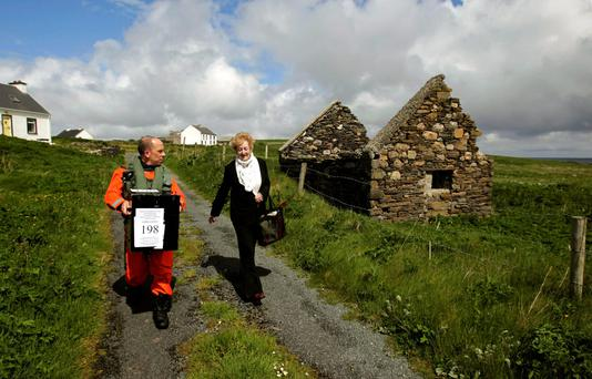 ISLAND LIFE: Sergeant Val Murray assists Presiding Officer Carmel McBride with the ballot box for the island of Inishbofin on the west coast in 2014