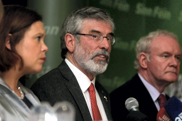 Gerry Adams (centre) with Sinn Fein deputy leader Mary Lou McDonald and Northern Ireland Deputy First Minister Martin McGuinness