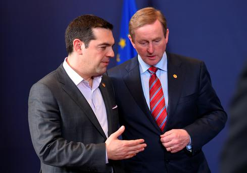 Greek Prime Minister Alexis Tsipras speaks with Taoiseach Enda Kenny at a European Council leaders' summit at the European Council in Brussels yesterday. Photo: Getty